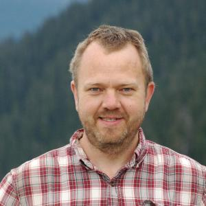 Dietmar Schwarz in plaid shirt with mountains in background